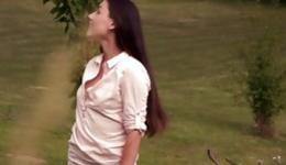 Hot beauty is getting naked outdoors and is stimulating her pussy hole