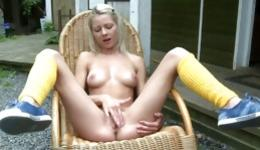 Hot blonde in her yellow stockings masturbating her shaved pussy hole