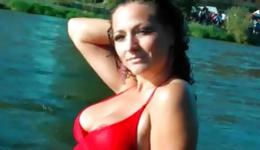 Hot brunette is in the river exposing her fabulous fit body and boobs