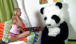 Horny blonde having a passionate intercourse with big panda toy