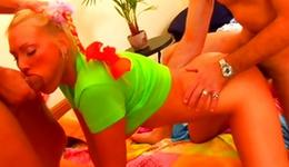 Light-haired whore lying there on ottoman with 2 males getting drilled deep