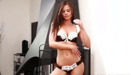 Seductive bitch in amazing underwear is undressing herself and posing