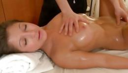 Stunning naked whore gets pounded from behind on massage table