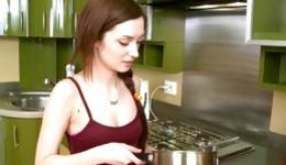 Hot teen beauty on her knees getting face fucked right in the kitchen